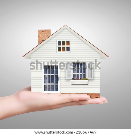 concept image,model house in hand  - stock photo