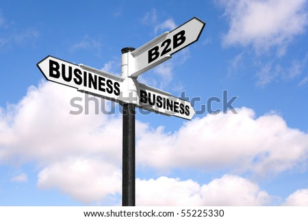 Concept image of a black and white signpost with the words B2B Business 2 Business against a blue cloudy sky.