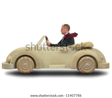 Concept image of a businessman driving to work in his environmentally friendly wooden car. - stock photo