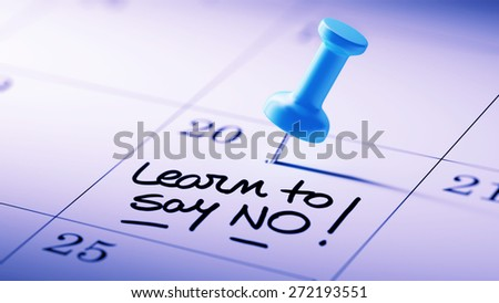 Concept image of a Calendar with a blue push pin. Closeup shot of a thumbtack attached. The words Learn to say no written on a white notebook to remind you an important appointment. - stock photo