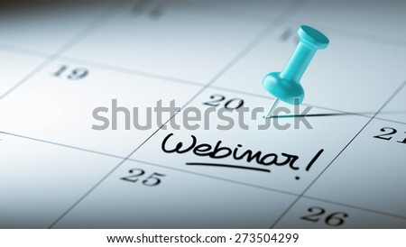 Concept image of a Calendar with a blue push pin. Closeup shot of a thumbtack attached. The words Webinar written on a white notebook to remind you an important appointment. - stock photo