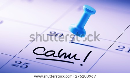 Concept image of a Calendar with a blue push pin. Closeup shot of a thumbtack attached. The words Calm written on a white notebook to remind you an important appointment. - stock photo