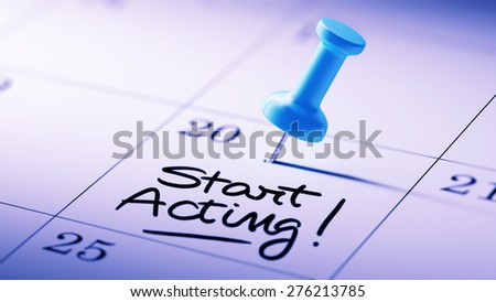 Concept image of a Calendar with a blue push pin. Closeup shot of a thumbtack attached. The words Start Acting written on a white notebook to remind you an important appointment. - stock photo