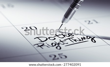 Concept image of a Calendar with a golden dart stick. The words Do the right thing written on a white notebook to remind you an important appointment. - stock photo