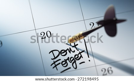 Concept image of a Calendar with a golden dart stick. The words Don`t Forget written on a white notebook to remind you an important appointment.