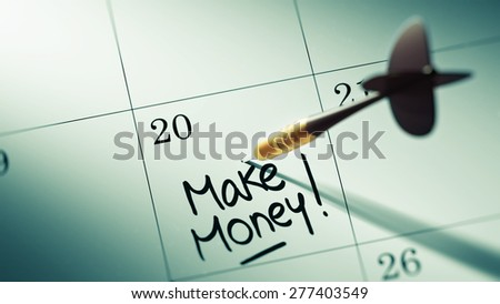 Concept image of a Calendar with a golden dart stick. The words Make Money written on a white notebook to remind you an important appointment. - stock photo