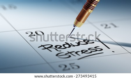 Concept image of a Calendar with a golden dart stick. The words Reduce Stress written on a white notebook to remind you an important appointment. - stock photo