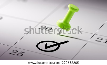 Concept image of a Calendar with a green push pin. Closeup shot of a thumbtack attached. Check Mark written on a white notebook to remind you an important appointment. - stock photo