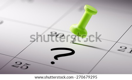 Concept image of a Calendar with a green push pin. Closeup shot of a thumbtack attached. Question Mark written on a white notebook to remind you an important appointment. - stock photo
