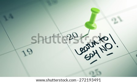 Concept image of a Calendar with a green push pin. Closeup shot of a thumbtack attached. The words Learn to say no written on a white notebook to remind you an important appointment. - stock photo