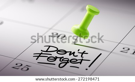 Concept image of a Calendar with a green push pin. Closeup shot of a thumbtack attached. The words Don`t Forget written on a white notebook to remind you an important appointment. - stock photo