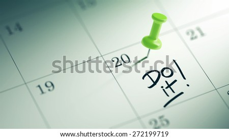 Concept image of a Calendar with a green push pin. Closeup shot of a thumbtack attached. The words Do it written on a white notebook to remind you an important appointment. - stock photo