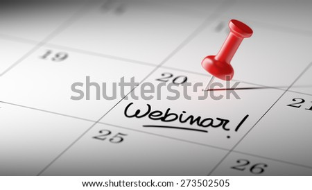 Concept image of a Calendar with a red push pin. Closeup shot of a thumbtack attached. The words Webinar written on a white notebook to remind you an important appointment. - stock photo