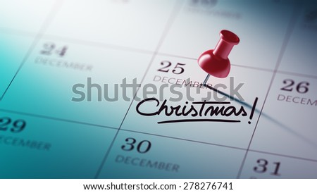 Concept image of a Calendar with a red push pin. Closeup shot of a thumbtack attached. The words Christmas written on a white notebook to remind you an important appointment. - stock photo