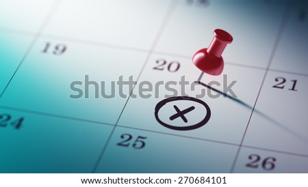 Concept image of a Calendar with a red push pin. Closeup shot of a thumbtack attached. X mark written on a white notebook to remind you an important appointment. - stock photo