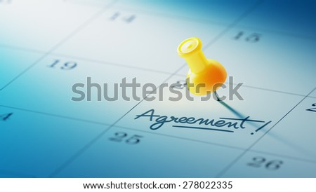 Concept image of a Calendar with a yellow push pin. Closeup shot of a thumbtack attached. The words Agreement written on a white notebook to remind you an important appointment. - stock photo