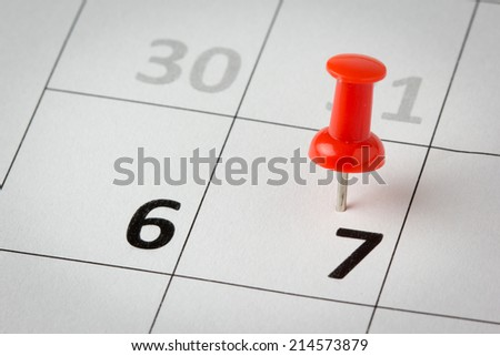 Concept image of a calendar with red push pins. Available in high resolution - stock photo
