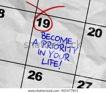 Concept image of a Calendar with the text: Become a Priority In Your Life - stock photo