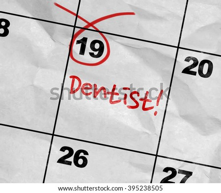 Concept image of a Calendar with the text: Dentist! - stock photo
