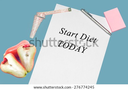 Concept image of a check list Diet. The empty  words start diet today written on a white notebook to remind you an important appointment. - stock photo