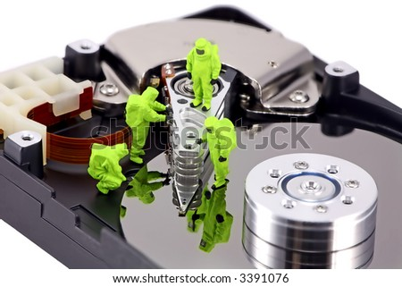 Concept image of a HAZMAT (Hazardous Materials) team closely inspecting a hard drive for viruses, spyware and trojans. - stock photo