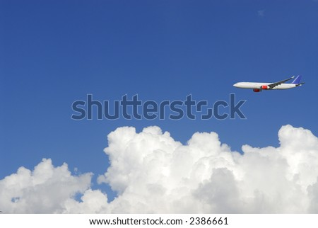 concept image of airplane, airbus flying above puffy white clouds