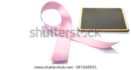 Concept image of breast cancer awareness pink ribbons with blank mini blackboard over white background