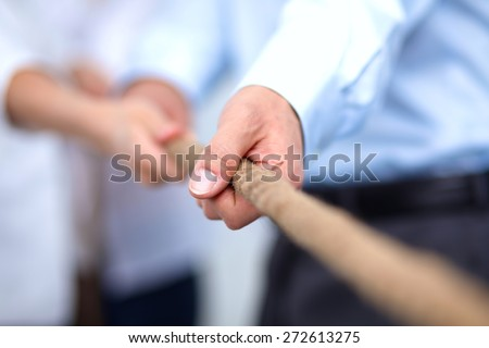 Concept image of business team using a rope as an element of the teamwork  - stock photo