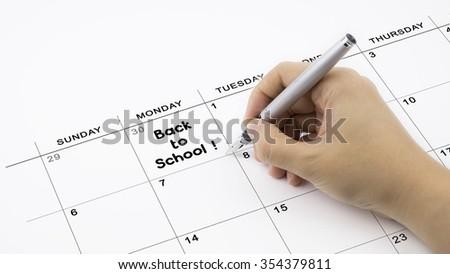 Concept image of calendar with a woman hand writing. Words Back to School written on calendar to remind you an important appointment.