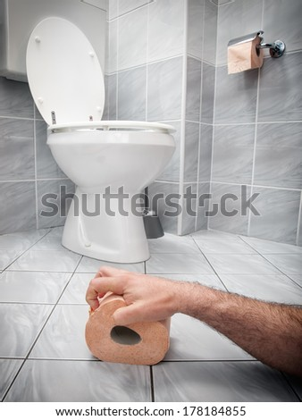 Concept image of digestive problems and difficulties in the toilet. - stock photo