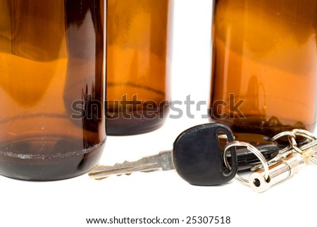 Concept image of drinking and driving with a shot of some car keys beside some empty beer bottles - stock photo