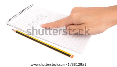 Concept image of female hand with vacation word on a notepad over white background