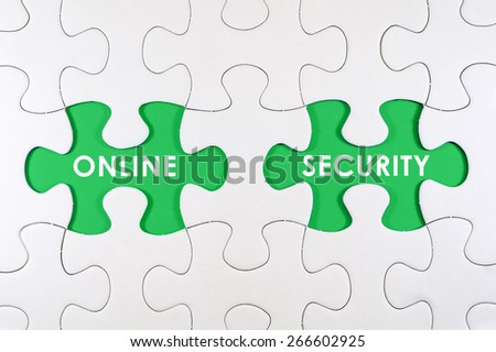 Concept image of missing puzzle pieces with ONLINE SECURITY words on green - stock photo