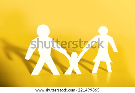 Concept image of paper cutout family - stock photo