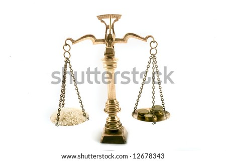 concept image of rice grains and coins on scales to illustrate the value of food - stock photo