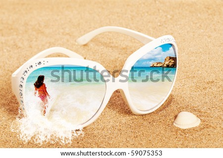 Concept image of summer holidays with beach scene in sunglasses on sand - stock photo