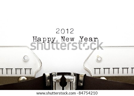 Concept image with 2012 HAPPY NEW YEAR written on an old typewriter - stock photo