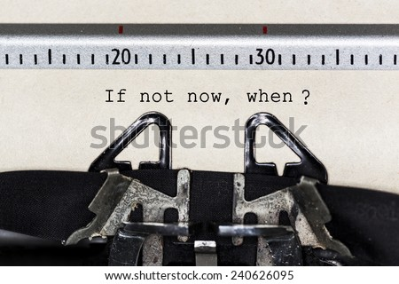 "Concept image with ""If Not Now, When?"" printed on an old typewriter - stock photo"