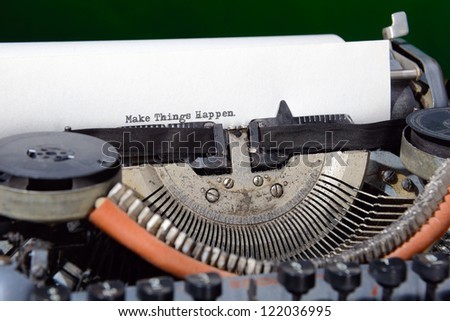 Concept image with Make Things Happen printed on an old typewriter - stock photo