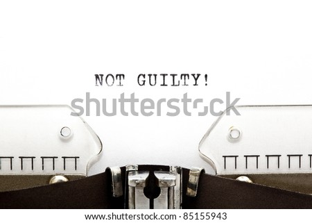 Concept image with NOT GUILTY! written on an old typewriter - stock photo
