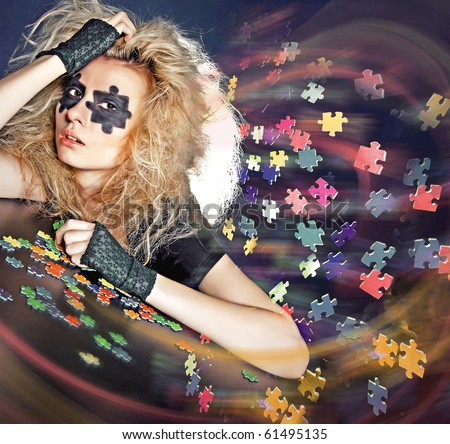 concept image - young girl with puzzle pieces - stock photo