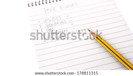 Concept images of notes of home budget expenses on a notepad