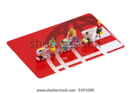 Concept images of shoppers with shopping carts on top of an unbranded credit card. Isolated on white background. - stock photo