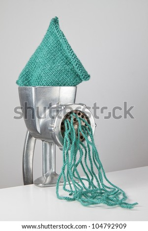 Concept images of textiles from the meat grinder. - stock photo