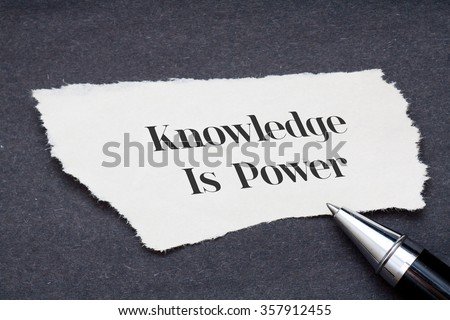 Concept:Knowledge is power written on torn paper with black background and pen - stock photo