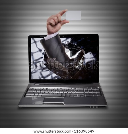 CONCEPT. laptop with broken screen and hand