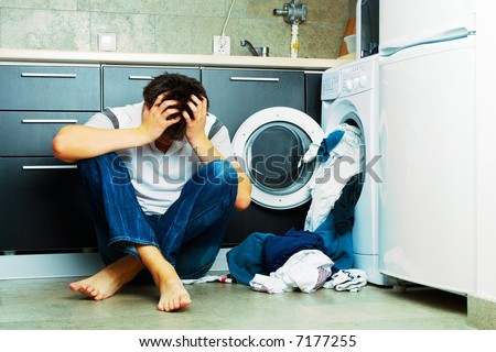 Concept Man stressed on the kitchen floor - stock photo
