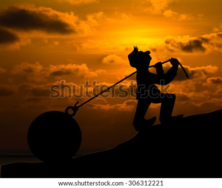 Concept man with pulling a heavy load ball silhouette - stock photo