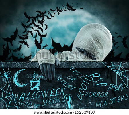 Concept mummy halloween. Mummy in a cemetery - stock photo