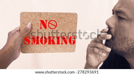 concept no smoking,hand women hold compression Board signal no smoking - stock photo